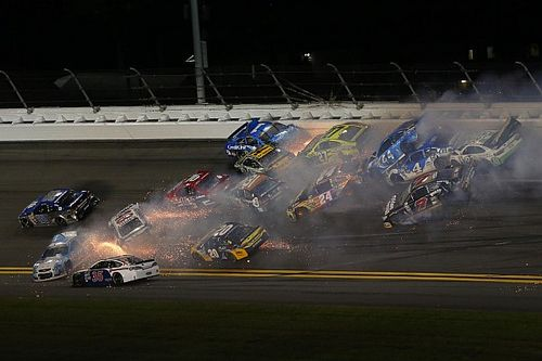 Half the field involved in massive wreck at Daytona - video