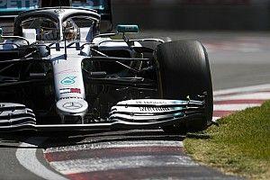 Vettel, primo, penalizzato per un taglio, Hamilton vince il GP del Canada