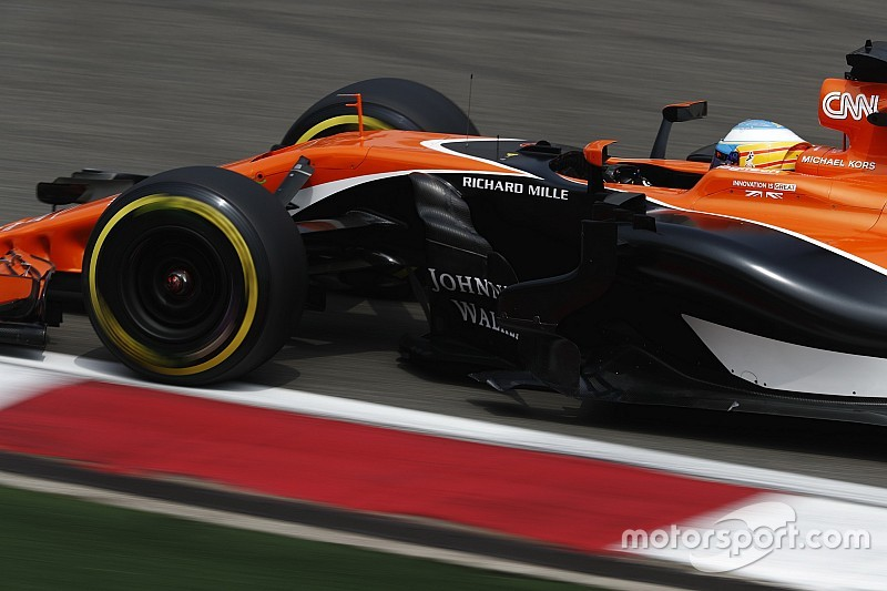 "Alonso says 13th on the grid a ""divine present"""