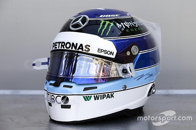 Bottas onora Hakkinen indossando il suo casco a Monaco