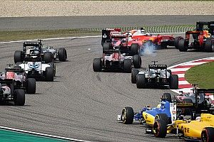 Vettel and Kvyat at odds over first-lap incident
