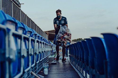 Vettel, Britanya GP'nin ardından tribünlerdeki çöplerin toplanmasına yardım etti