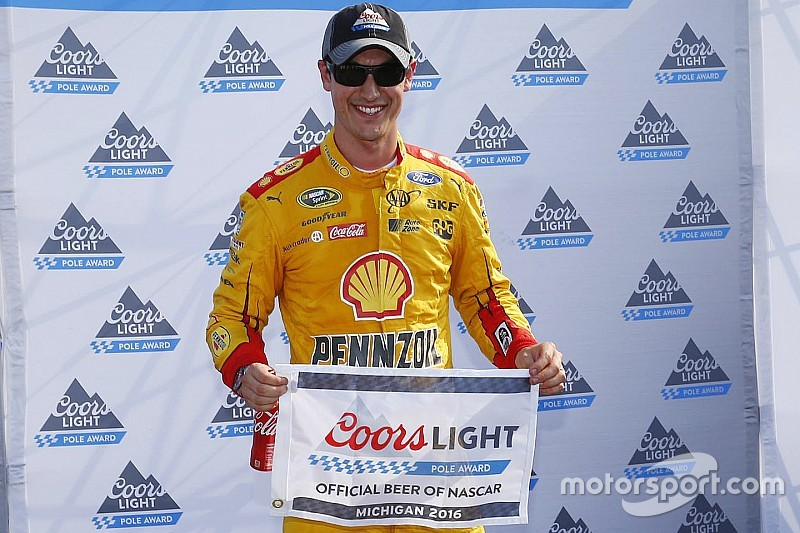 Logano takes Michigan pole, Harvick bit by cautions