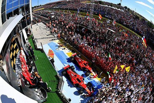 Die Geschichte zum Bild: Vettel genießt den F1-Triumph
