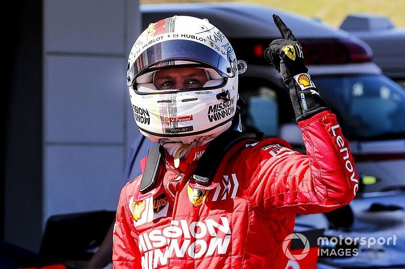 Japanese GP: Vettel on pole as Ferrari locks out front row