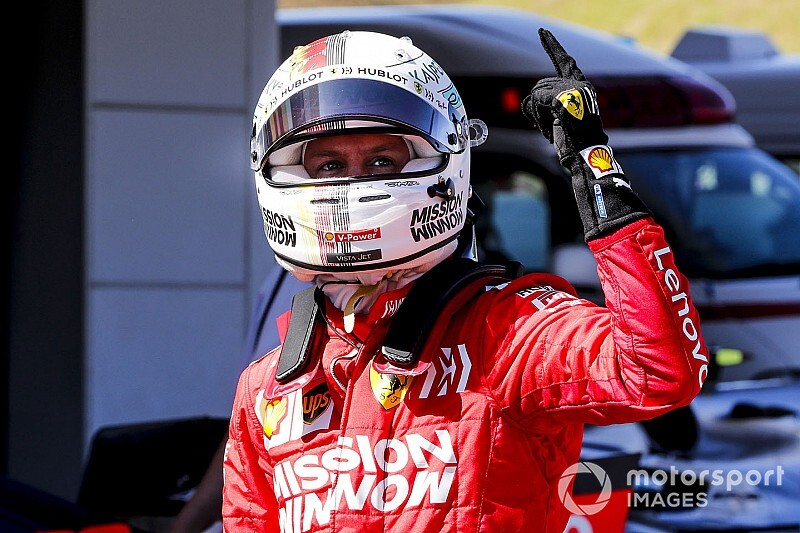 Japanese GP: Vettel on pole as Ferrari locks out front row