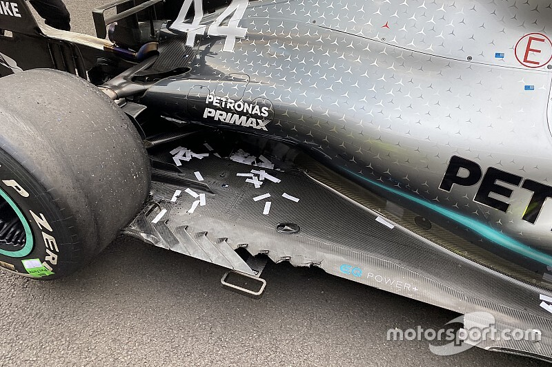 "Hamilton: Floor damage costing me a ""good couple of tenths"""
