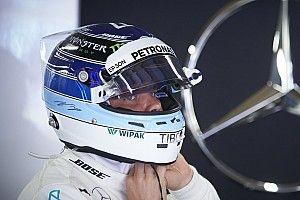 Ретро, блестки и патриотизм. Особые шлемы гонщиков Ф1 в сезоне-2018