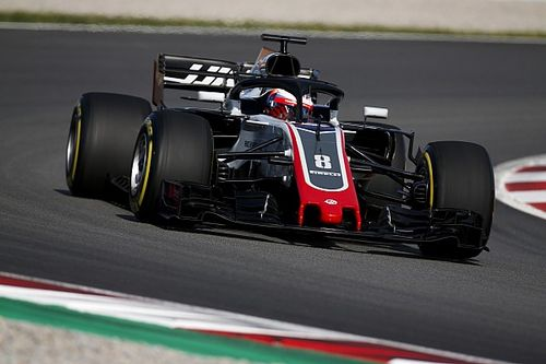 Grosjean quickest as Barcelona test kicks off