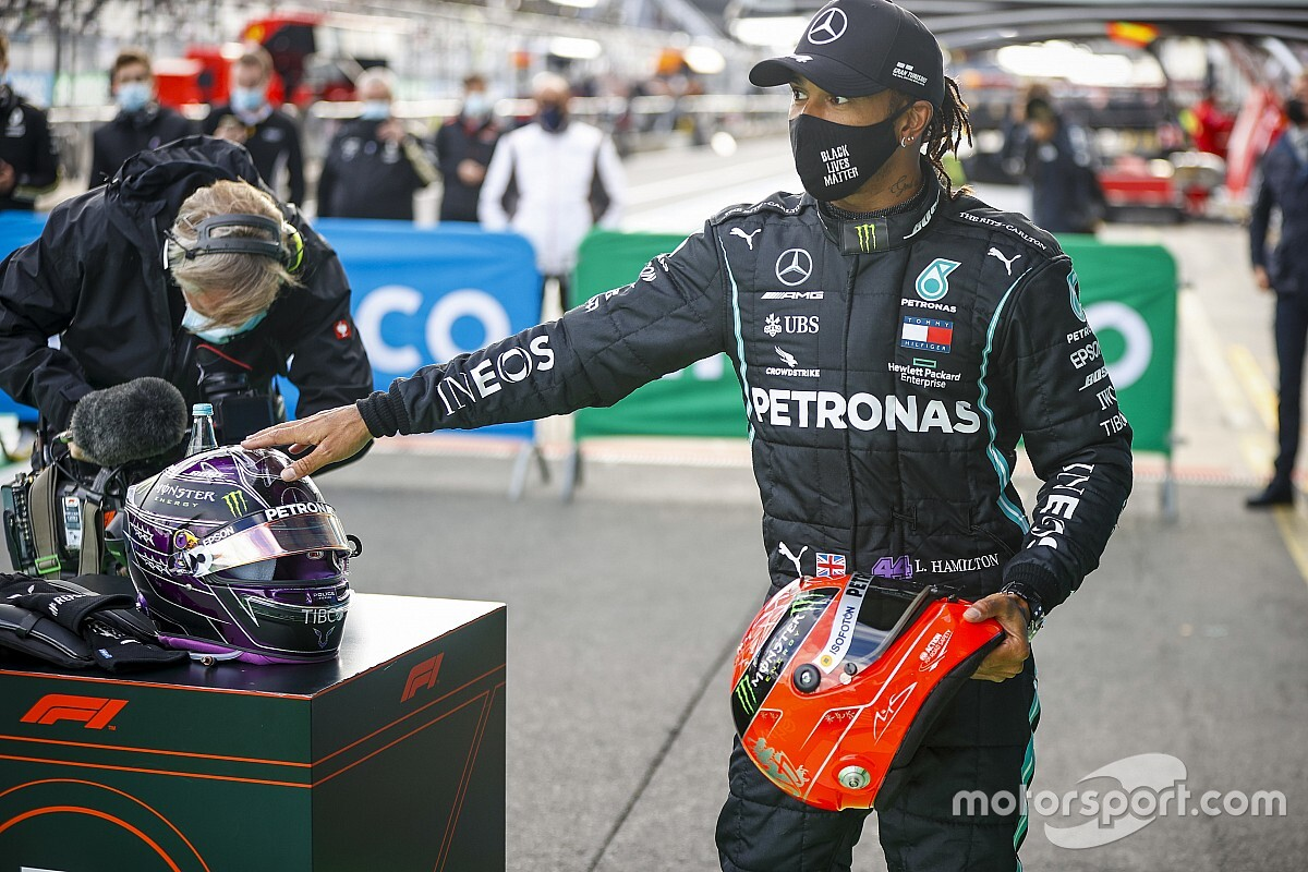 Hamilton presented with Schumacher helmet after record win