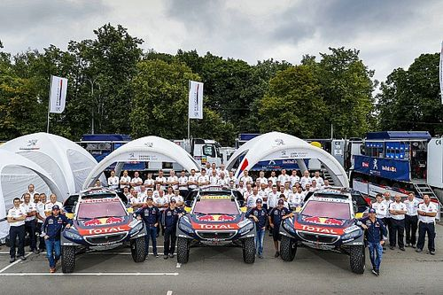 The starting pistol fires for Peugeot and Kamaz at Silk Way Rally
