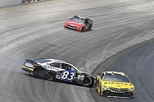 Suarez avoids carnage for career-best finish at Dover