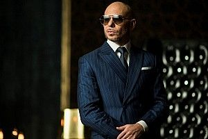 "Pitbull sees his NASCAR ownership as ""a higher calling"""