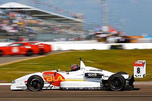 Martin edges tight battle for pole at IMS