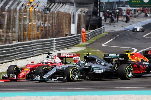 Vettel insists he is not overdriving after Sepang crash
