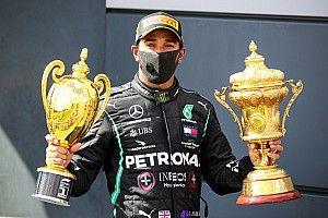 British GP: Hamilton wins on three wheels after late drama