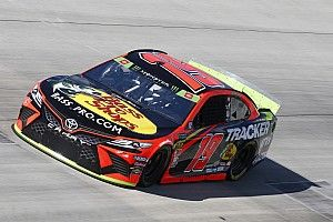 Truex takes advantage of slower traffic, wins Stage 2 at Dover