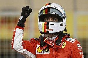 Vettel dolblij met pole, Raikkonen had last van verkeer