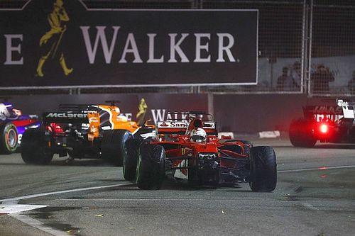"""Vettel: """"Zag opeens Kimi en Max voorbij schieten na tik"""""""