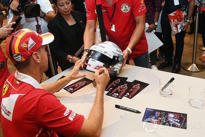 Fényvisszaverős színjáték Vettel sisakján