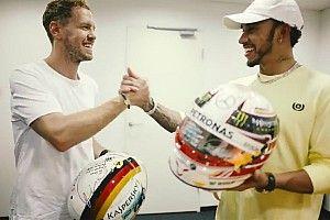 Vettel y Hamilton intercambian sus cascos tras un intenso 2018