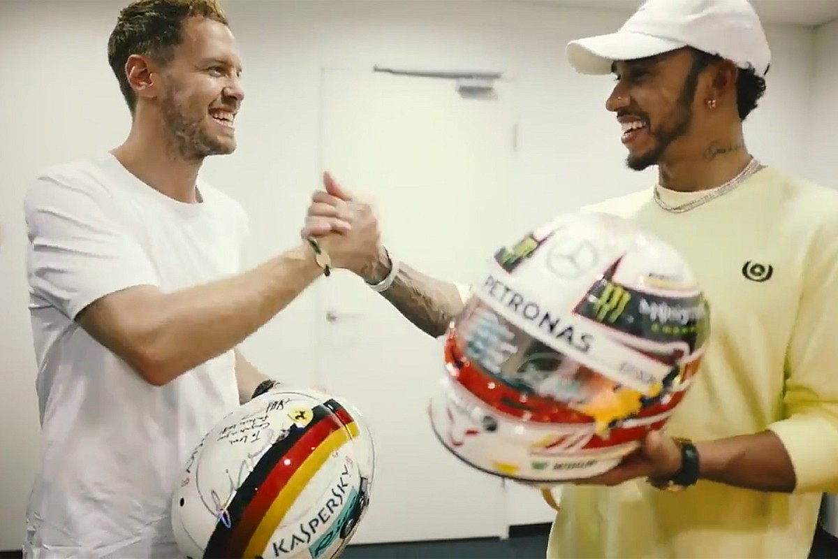 Vettel, Hamilton exchange helmets after F1 finale