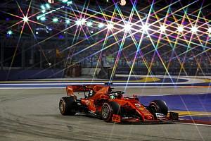 Vettel se beneficia de estratégia da Ferrari, quebra jejum e vence GP de Singapura
