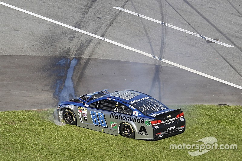 Dale Earnhardt Jr. pounds the inside wall late in the Daytona 500