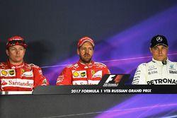 Polesitter Sebastian Vettel, Ferrari, tweede plaats Kimi Raikkonen, Ferrari, derde plaats Valtteri B