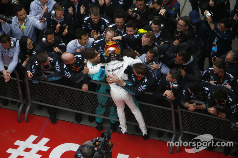 Lewis Hamilton, Mercedes AMG, celebrates victory with his team in parc ferme