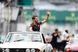 Romain Grosjean, Haas F1 Team, waves from a Triumph Stag on the drivers parade