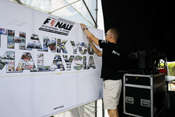 Valtteri Bottas, Mercedes AMG F1, puts his autograph on a wall on the F1 stage