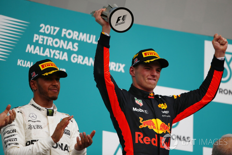 Winner Max Verstappen, Red Bull Racing, raises his trophy on the podium