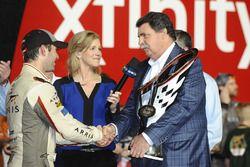 2016 Champion and race winner Daniel Suarez, Joe Gibbs Racing Toyota, NASCAR chairman Mike Helton wi