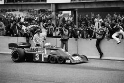Jody Scheckter, Tyrrell P34-Ford, stops in front of his team after the win