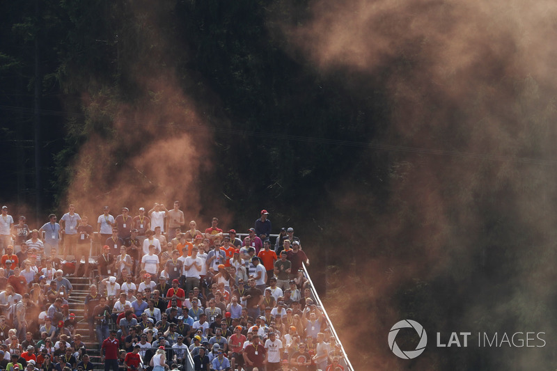 Dutch fans set off oramge flares from a stand