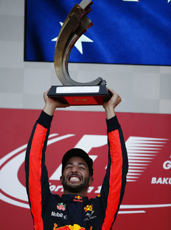 Daniel Ricciardo, Red Bull Racing, raises his winner's trophy on the podium