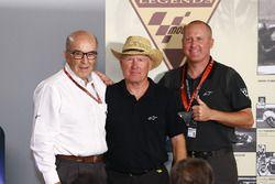 Carmelo Ezpeleta, CEO of Dorna Sports, Kenny Roberts Sr., Kenny Roberts Jr.