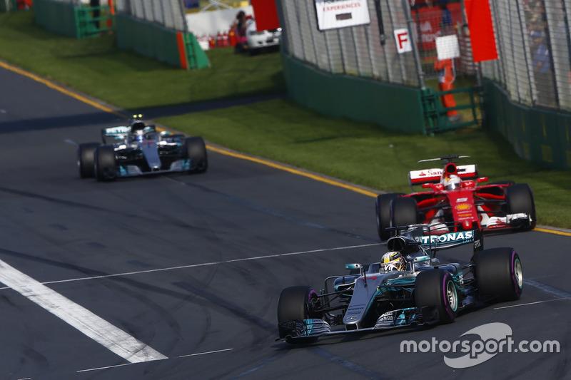Lewis Hamilton, Mercedes AMG F1 W08, leads Sebastian Vettel, Ferrari SF70H, and Valtteri Bottas, Mercedes AMG F1 W08