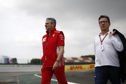 Maurizio Arrivabene, Ferrari Team Principal and Louis Camilleri, Chairman of Philip Morris walk the track