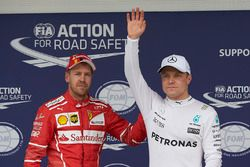 Front row starters, pole man Valtteri Bottas, Mercedes AMG F1, Sebastian Vettel, Ferrari