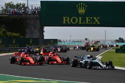 Valtteri Bottas, Mercedes-AMG F1 W09 leads Sebastian Vettel, Ferrari SF71H and Kimi Raikkonen, Ferrari SF71H at the start of the race