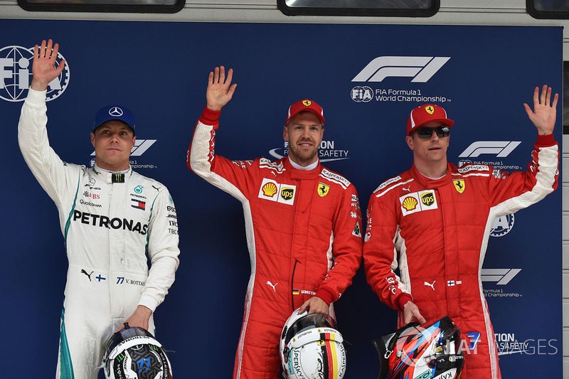 Polesitter Sebastian Vettel, Ferrari, second place Kimi Raikkonen, Ferrari, third place Valtteri Bot