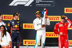 Max Verstappen, Red Bull Racing, 2nd position, Lewis Hamilton, Mercedes AMG F1, 1st position, with his trophy, Kimi Raikkonen, Ferrari, 3rd position, on the podium