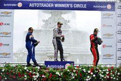 Rafael Matos, Tony Buffomante, and Gar Robinson celebrate the TA2 overall podium