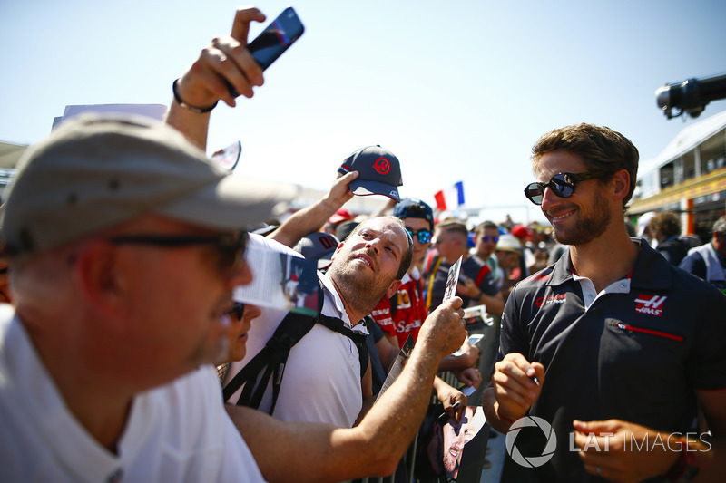 Romain Grosjean, Haas F1 Team, signs autographs and has his picture taken by fans
