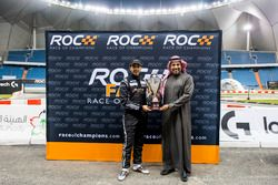 Khaled Al Qubaisi, is presented with a trophy by Prince Khaled Al Faisal, President of the Motor Fed