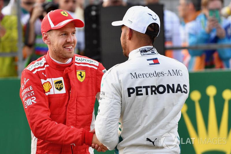 Sebastian Vettel, Ferrari amd Lewis Hamilton, Mercedes-AMG F1 celebrate in parc ferme