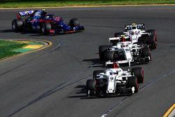 Marcus Ericsson, Sauber C37 leads Charles Leclerc, Sauber C37