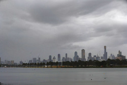 Clouds gather over the Melbourne skyline